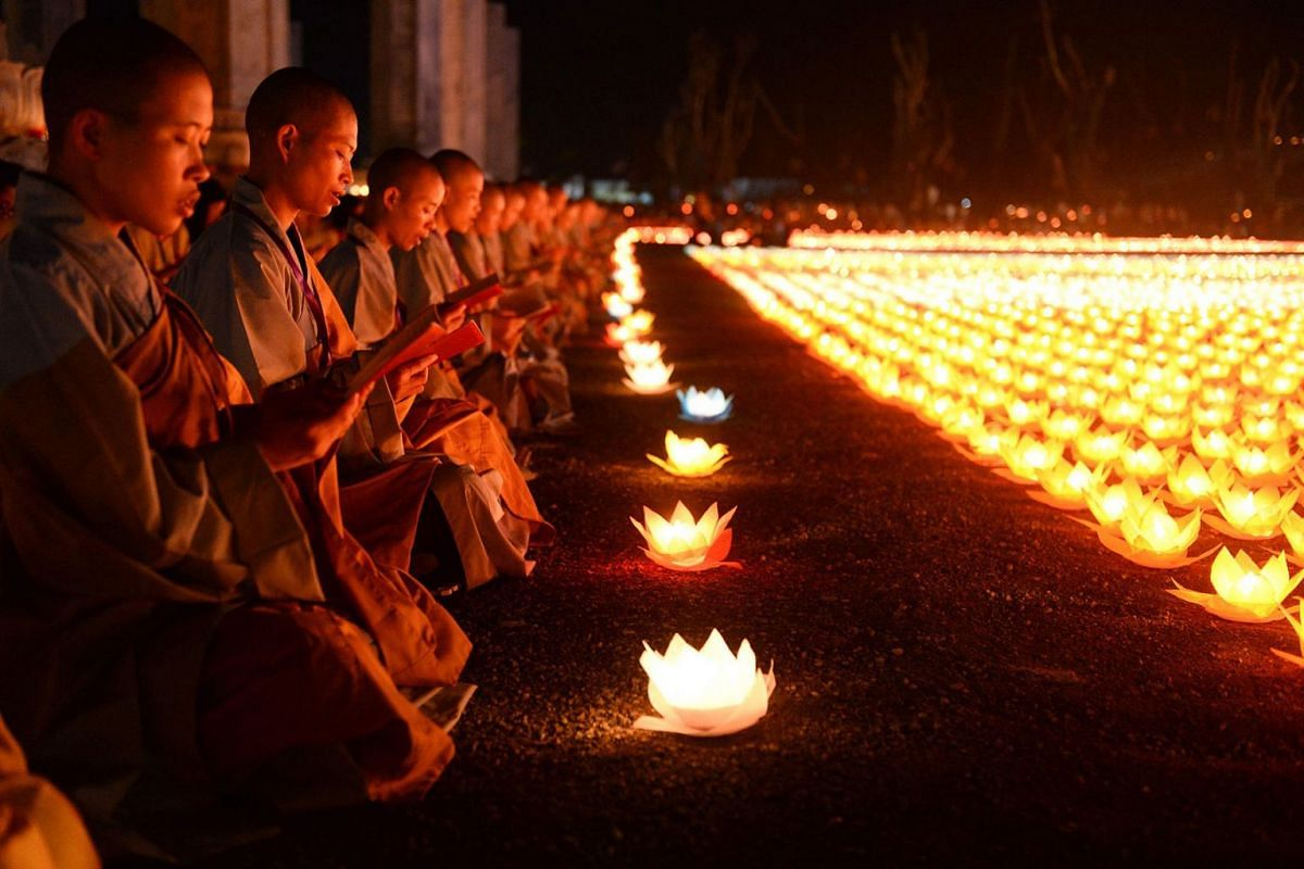 Buddhist nuns pray during a ceremony at the Tam Chuc pagoda in Ha Nam province on May 13, 2019, ahead of Vesak Day celebrations. PHOTO: AFP