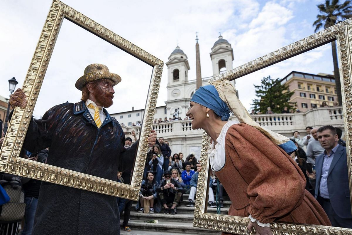 Italian singers Biagio Antonacci (L) dressed as Vincent van Gogh and Laura Pausini dressed as 'Girl with a Pearl Earring' (Artwork by Dutch artist Johannes Vermeer) pose in Trinita dei Monti in Rome, Italy, May 14, 2019. PHOTO: EPA-EFE