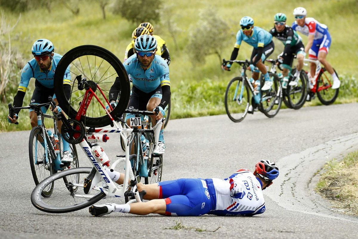 Team Groupama-FDJ rider France's Olivier Le Gac crashes during the stage four of the 102nd Giro d'Italia - Tour of Italy - cycle race, 235kms from Orbetello to Frascati on May 14, 2019. PHOTO: AFP