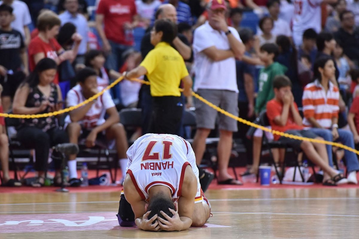 Ng Han Bin  of the Singapore Slingers reacts to the  84-81 loss to CLS Knights Indonesia in Game 5 of the Asean Basketball League (ABL) Finals, May 15, 2019. PHOTO: THE STRAITS TIMES/JASMINE CHOONG