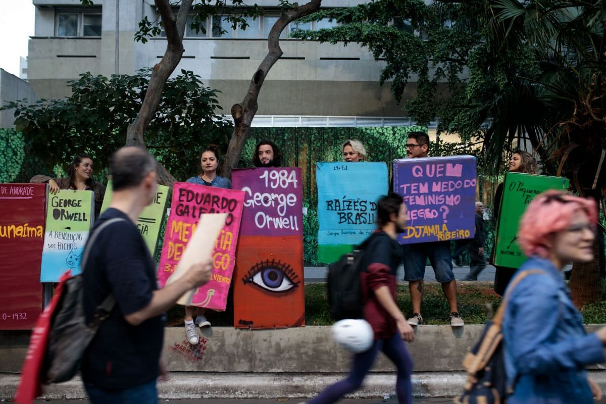 "Demonstrators gather on Paulista Avenue during a protest with the slogan ""Books Yes, Weapons No"" in Sao Paulo on May 15, 2019."
