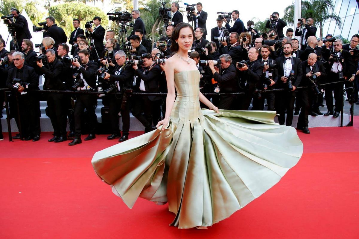Model Kiko Mizuhara poses as she arrives for the screening of the film Les Miserables at the 72nd annual Cannes Film Festival, on May 15, 2019.