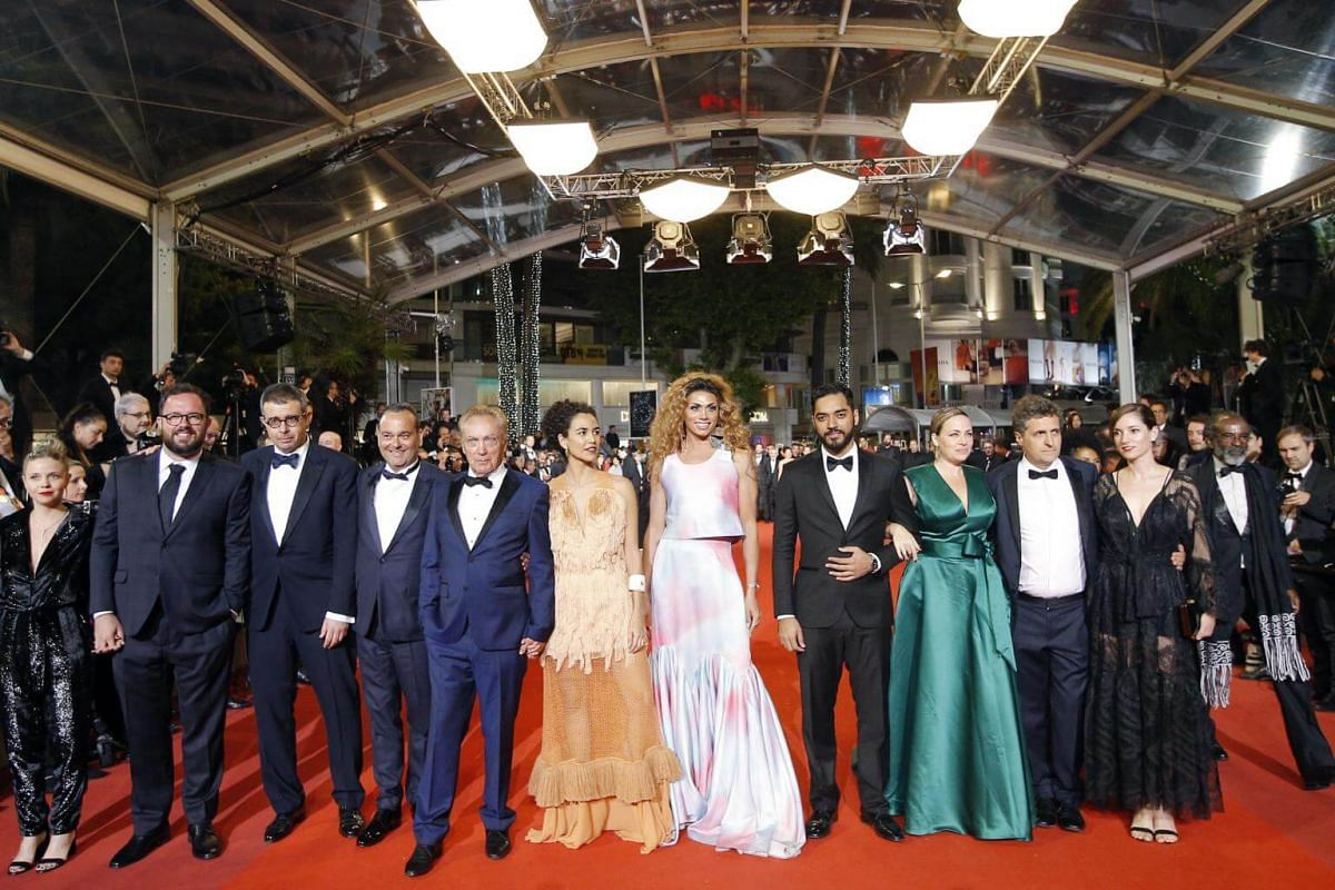 Directors Juliano Dornelles, Kleber Mendonca Filho and cast members of Bacurau pose as they arrive for the screening of their film at the 72nd edition of the Cannes Film Festival in Cannes, France, on May 15, 2019.
