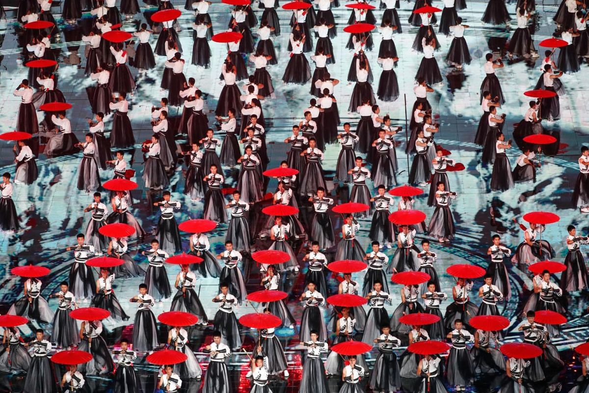 """Artists perform """"The Charm of Chinese Ink Art"""" display during the Asian Culture Carnival at the National Stadium, known as the Bird's Nest, in Beijing, China on May 15, 2019."""