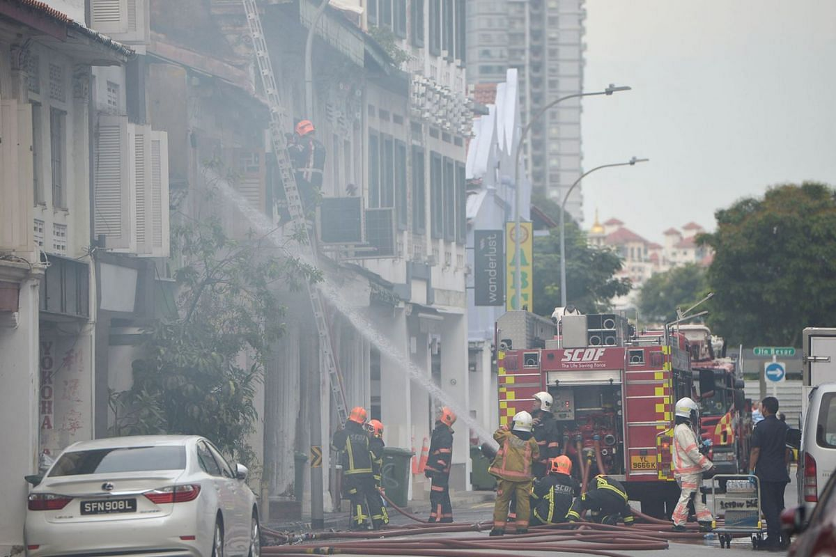 A fire broke out on Thursday, May 16, 2019, at a two-storey shophouse in Little India, Singapore, sending thick grey smoke into the air around it. PHOTO: SHINTARO TAY