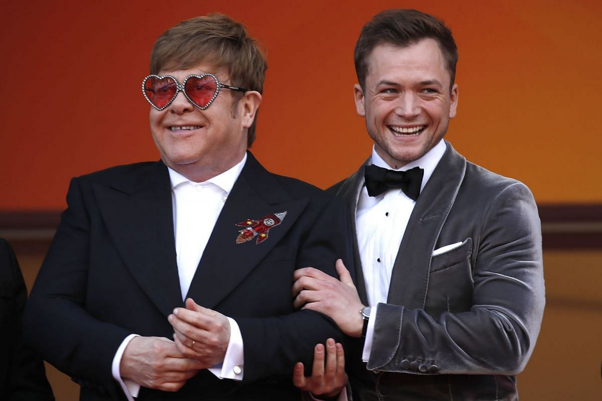 British musician and producer Elton John (L) and British actor Taron Egerton arrive for the screening of 'Rocketman' during the 72nd annual Cannes Film Festival, in Cannes, France, May 16, 2019. PHOTO: EPA-EFE