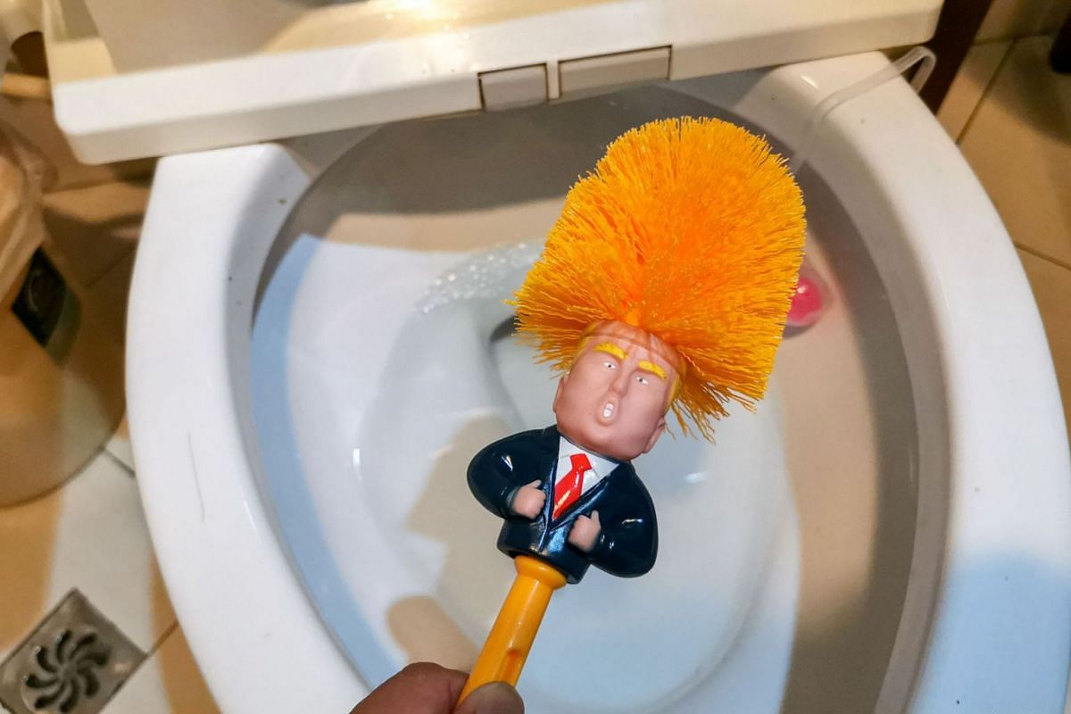 This photo taken on May 15, 2019 shows a Donald Trump themed toilet brush displayed at a home in Shanghai. The brushes, which sell for 23 Yuan (US $3.34) have become popular on online shopping platforms since a trade war between the US and China esca