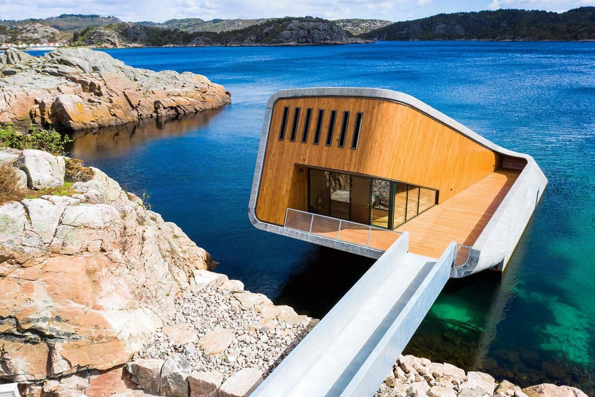 A photo issued on May 2, 2019 shows a view of Under, a restaurant that is semi-submerged beneath the waters of the North Sea in Lindesnes near Kristiansand, some 400 km south west of Oslo. PHOTO: AFP