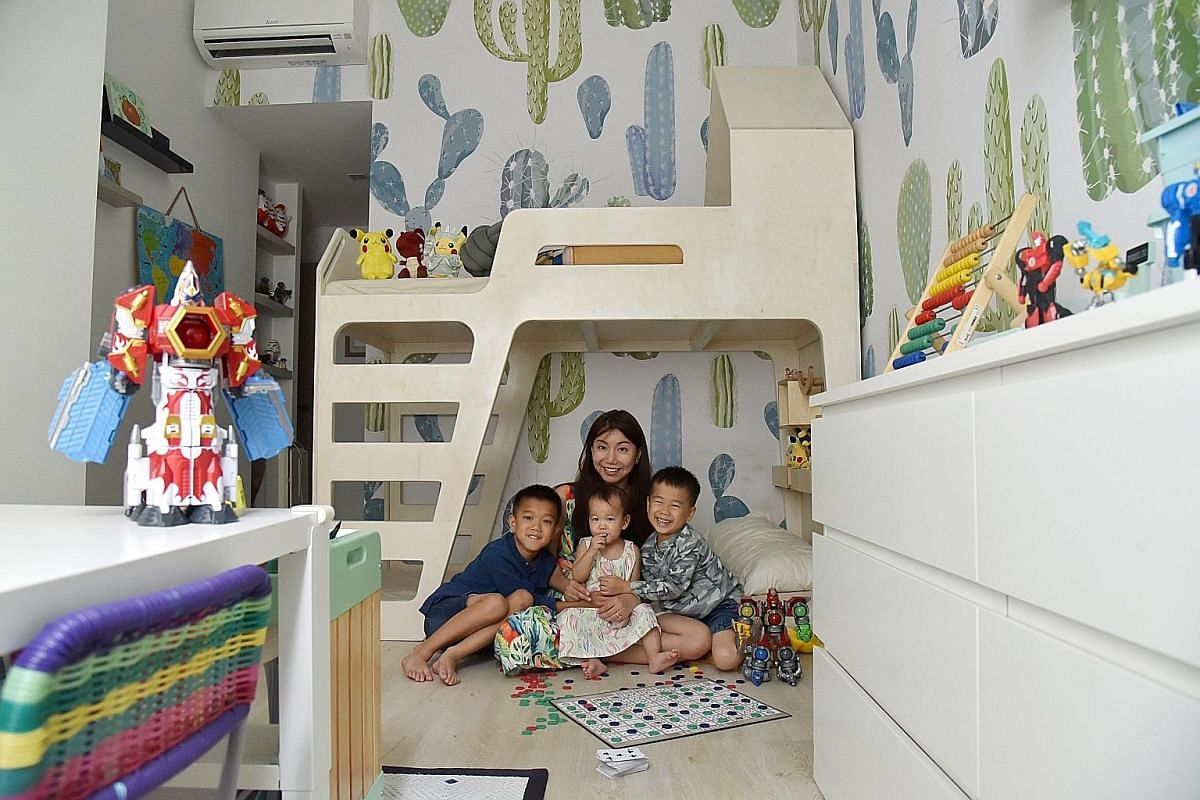 Realtor Natasha Goh with her three children in the boys' room, which features cacti prints on walls and furniture in neutral colours.