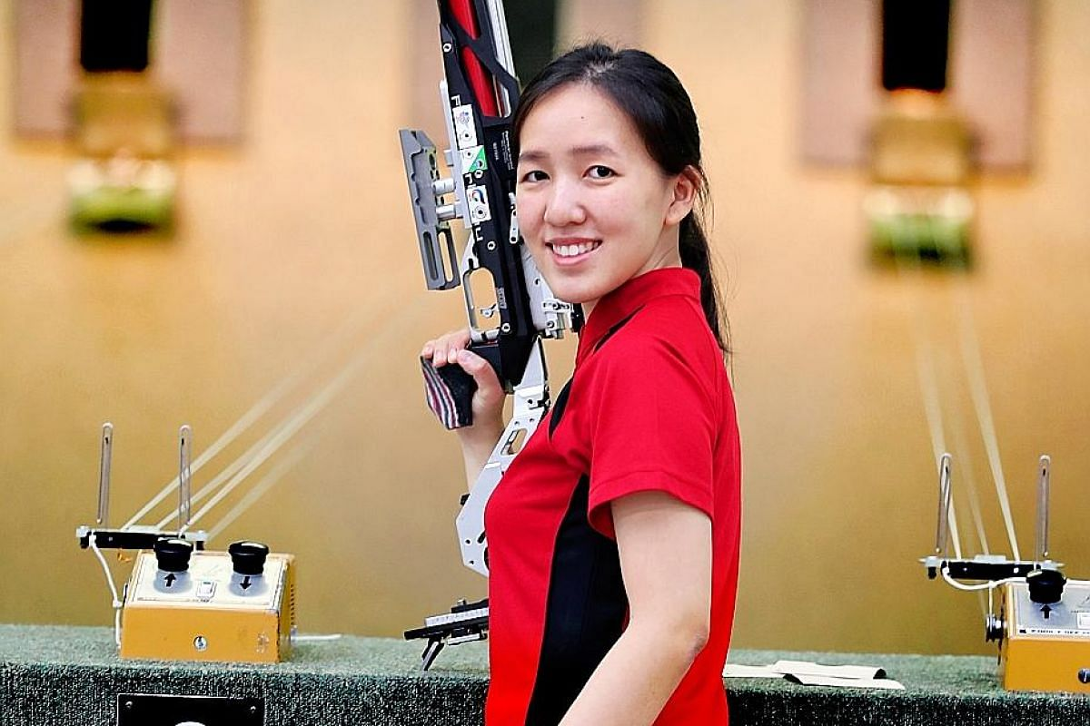 Jasmine Ser and her 10m air rifle, which weighs 5kg and has over 300 precise parts. ST PHOTO: JONATHAN CHOO