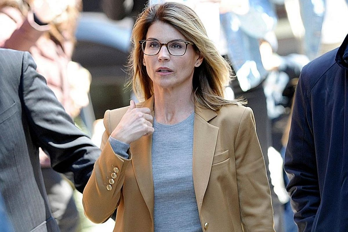 "College admissions consultant William ""Rick"" Singer has pleaded guilty to charges related to the scandal, while actress Felicity Huffman (centre) and actress Lori Loughlin are allegedly involved. The University of Southern California (USC) in Los Ang"