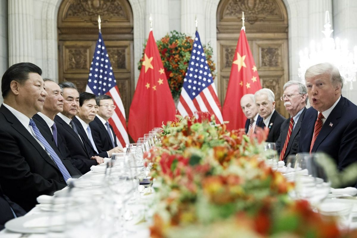 US President Donald Trump and China's President Xi Jinping at a working dinner in Buenos Aires in December. Mr Trump recently accused Beijing of backtracking on commitments for a proposed trade deal, which Beijing denies.