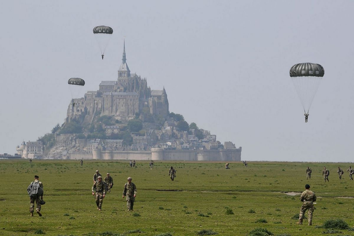 US paratroopers walk back after jumping over Le Mont-Saint-Michel, north-western France on May 18, 2019, less than three weeks before the 75th anniversary of the D-Day landings. PHOTO: AFP