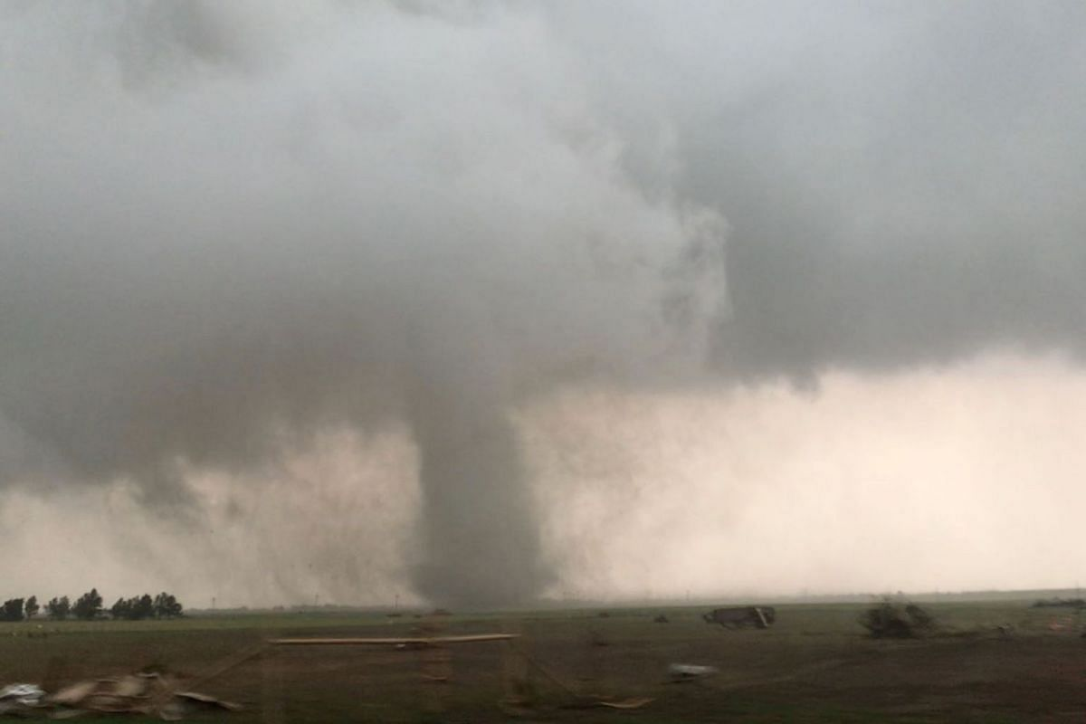 A tornado spins during stormy weather in Mangum, Oklahoma, U.S., May 20, 2019, in this still image taken from video from social media. PHOTO: LORRAINE MATTI VIA REUTERS