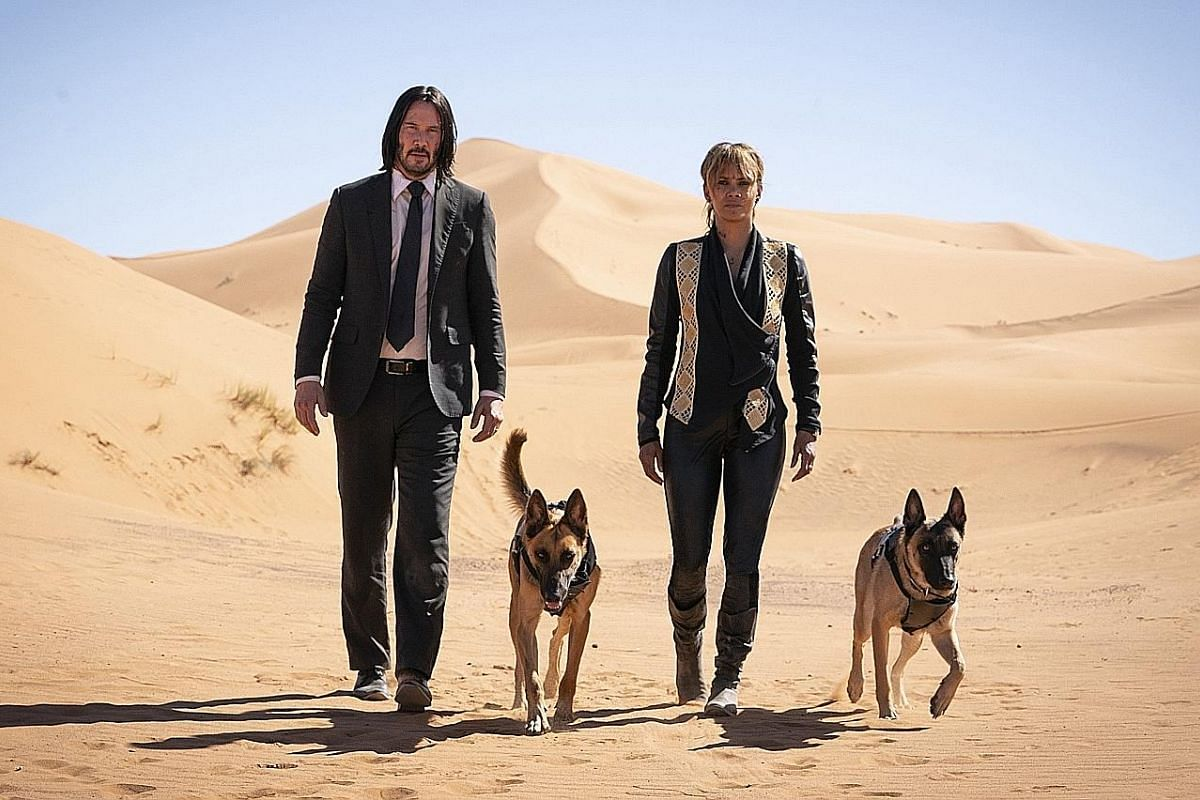 Keanu Reeves reprises his role as John Wick, while Halle Berry plays Sofia (both above).
