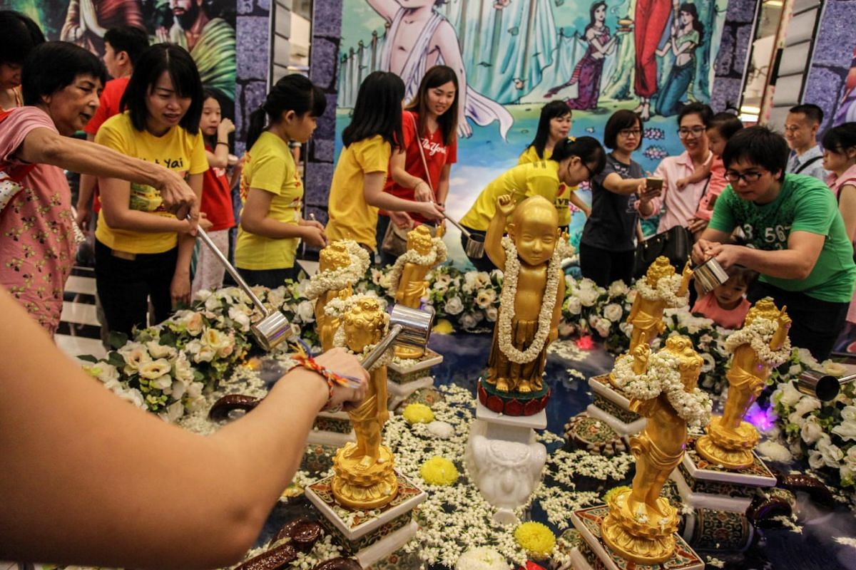 Indonesian Buddhists use fragrant water to bathe figures of Buddha during a ceremony celebrating Vesak Day in  Medan, Indonesia, on May 19, 2019.
