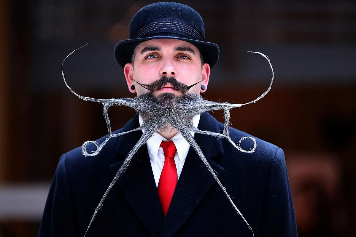 A participant taking part in one of the 17 categories of beard and moustache styles at the international World Beard and Moustache Championship in Antwerp, Belgium.
