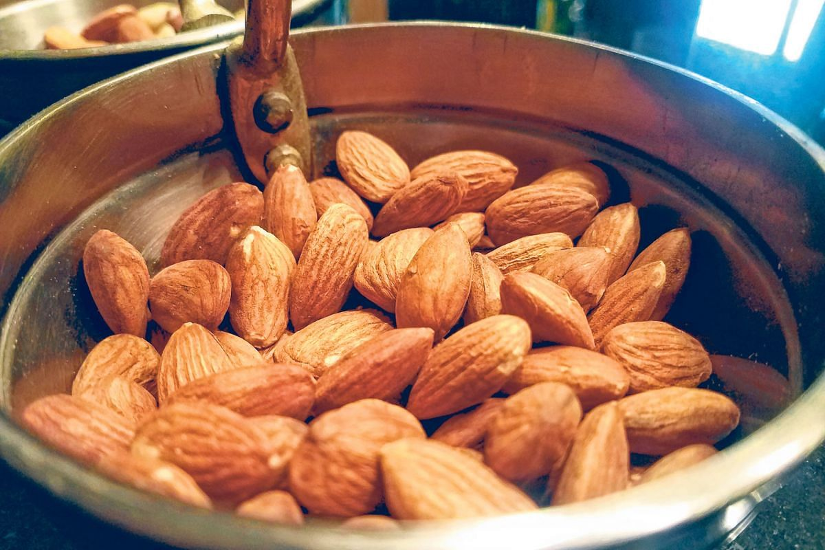 The California almond industry, facing criticism, has reduced its water consumption and has plans to cut water use further.