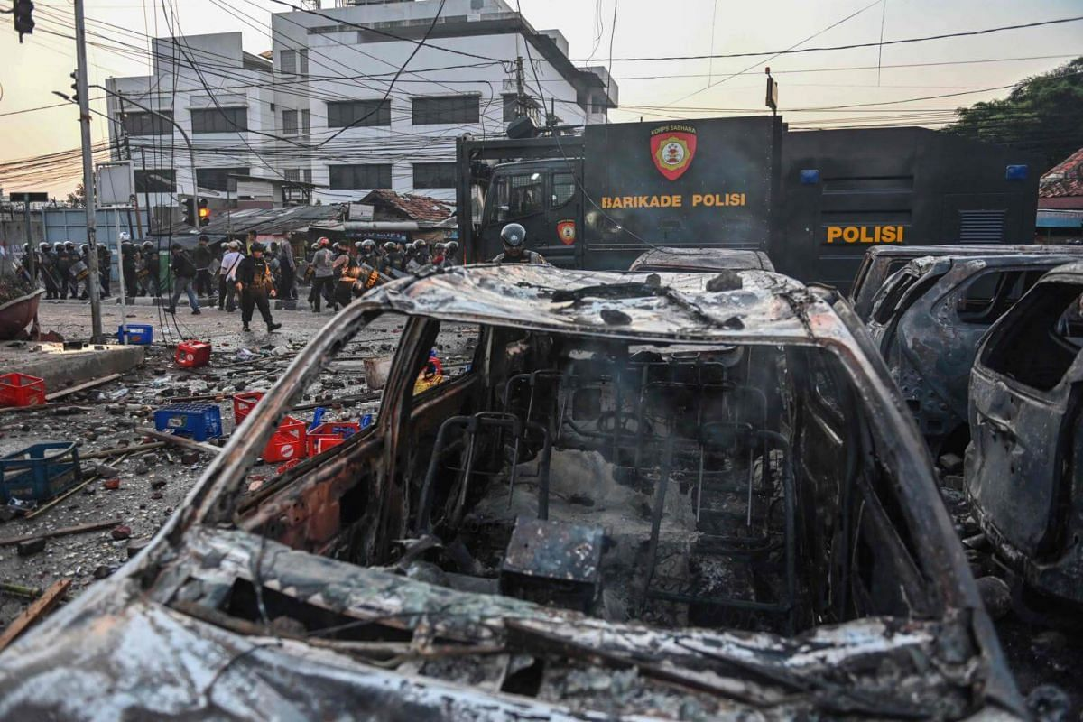 Cars burned by the mob from an overnight demonstration near the election supervisory board building in Jakarta seen on May 22, 2019.