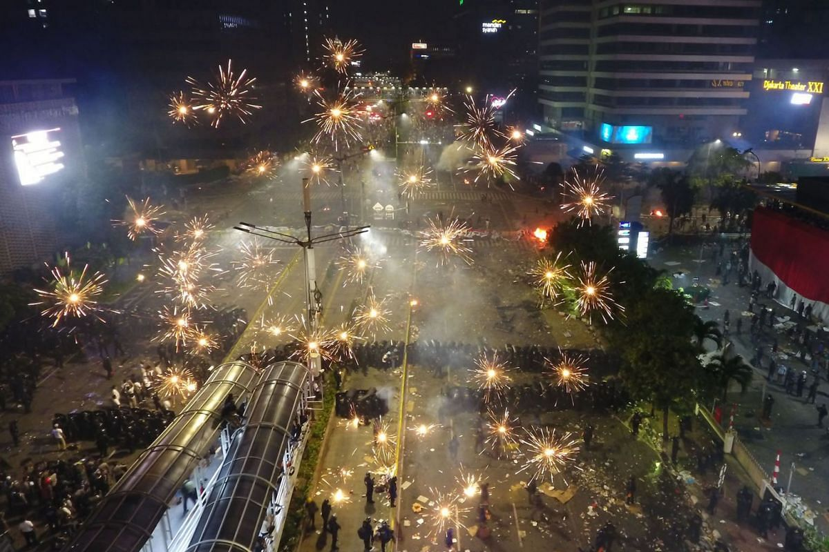 Fireworks explode as demonstrators clash with police during a protest in this aerial photograph taken above Jakarta, Indonesia, on Wednesday, May 22, 2019. PHOTO: BLOOMBERG