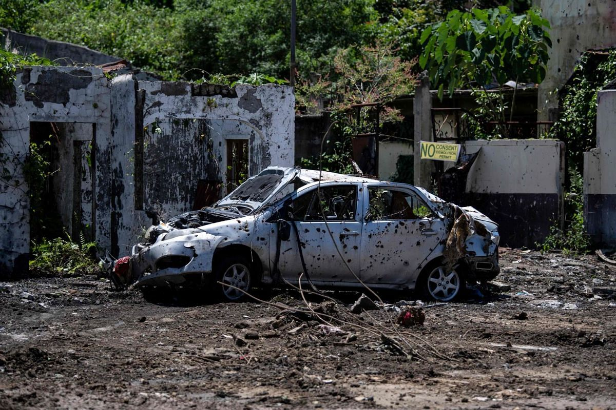 A bullet-riddled car in Marawi on the southern island of Mindanao.