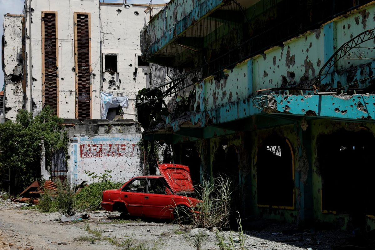 An abandoned car in a derelict area where some of the worst fighting took place.