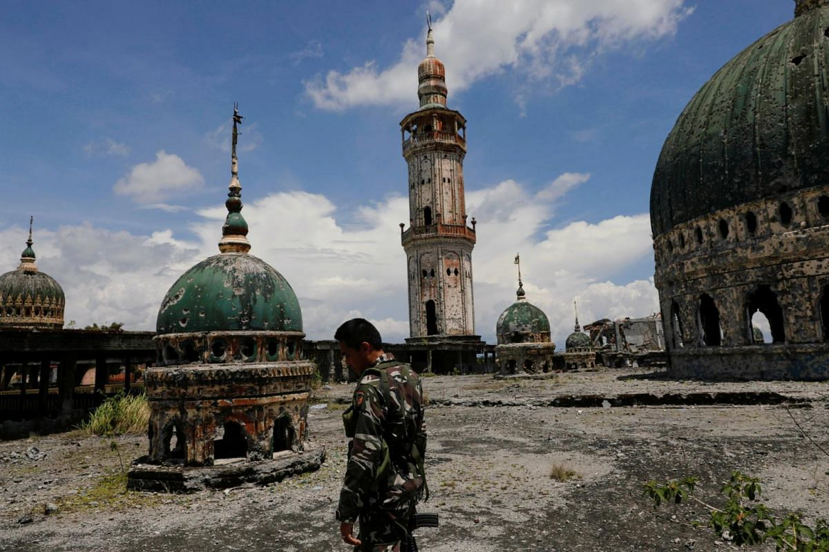 A soldier walking on the rooftop area of the war-torn Grand Mosque in Marawi city.