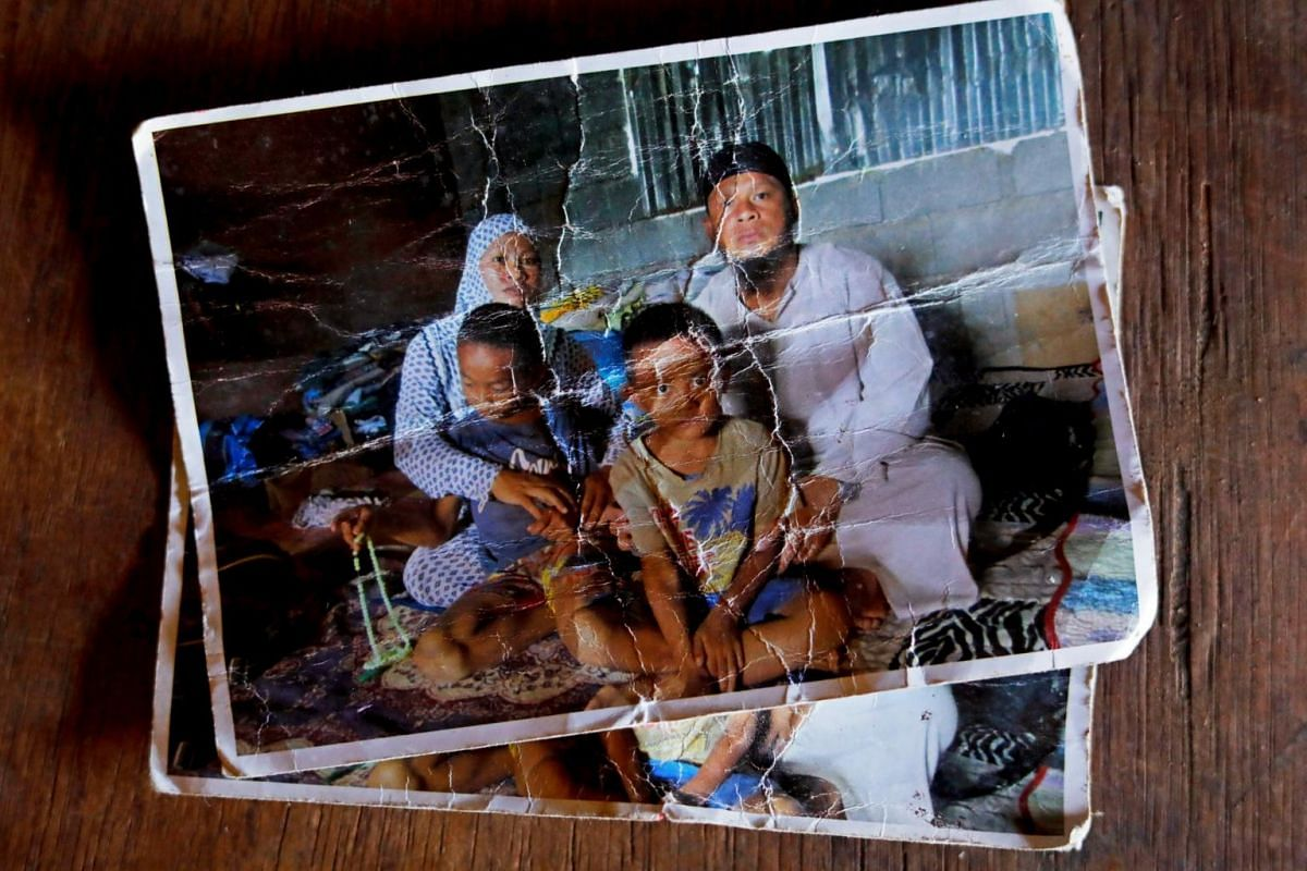 A photo of the Acampong family, before they left Marawi in 2017. The Acampongs now live in a tiny temporary housing unit on the city's outskirts, competing with thousands of families for water and other basic utilities.