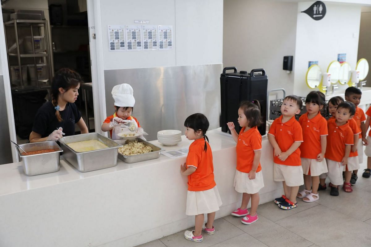 Children waiting to have their meals at My First Skool's first and largest early-years centre in Punggol Drive, May 23, 2019. PHOTO: THE STRAITS TIMES/ONG WEE JIN