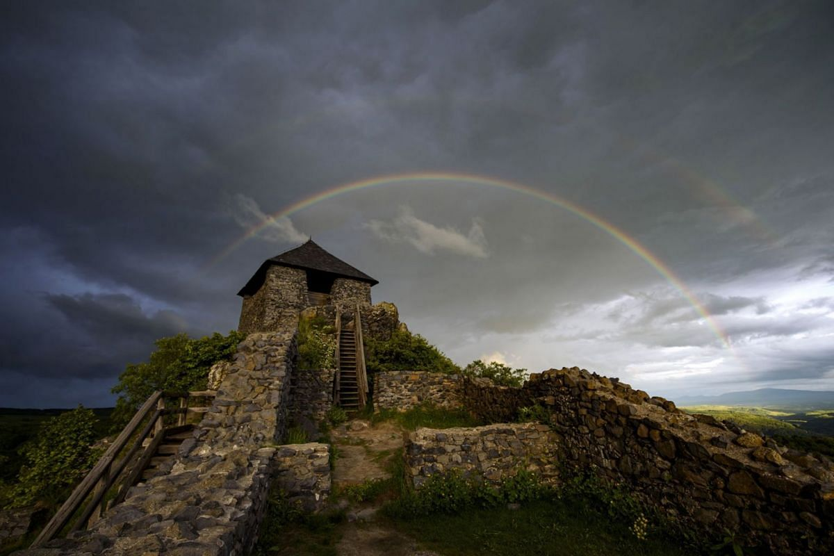 Double rainbows are visible in the sky at the Salgo Castle near Salgotarjan, Hungary, May 23, 2019. PHOTO: EPA-EFE