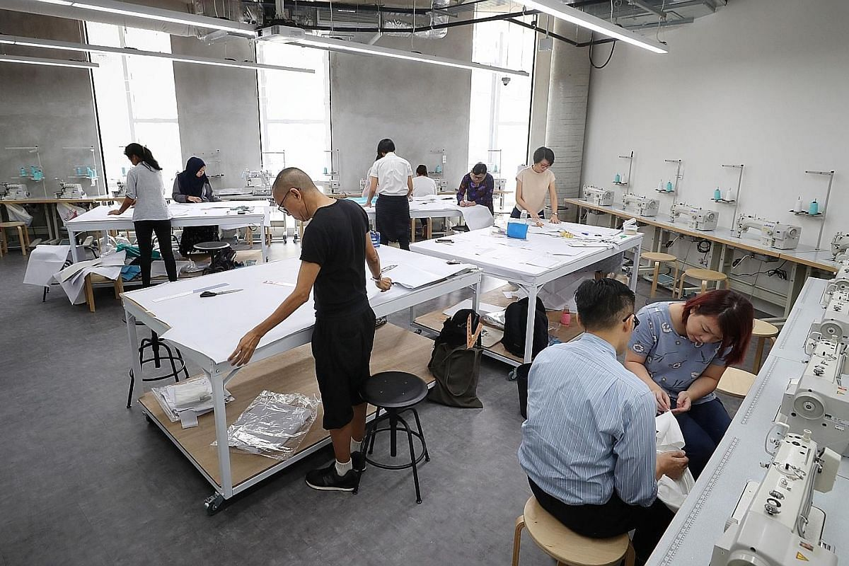 The Cave, or theatre, at The Cocoon Space. Members can work from personal pods (far left) or the communal workspace (left). A workshop being conducted in The Makers Studio of The Cocoon Space in Design Orchard.