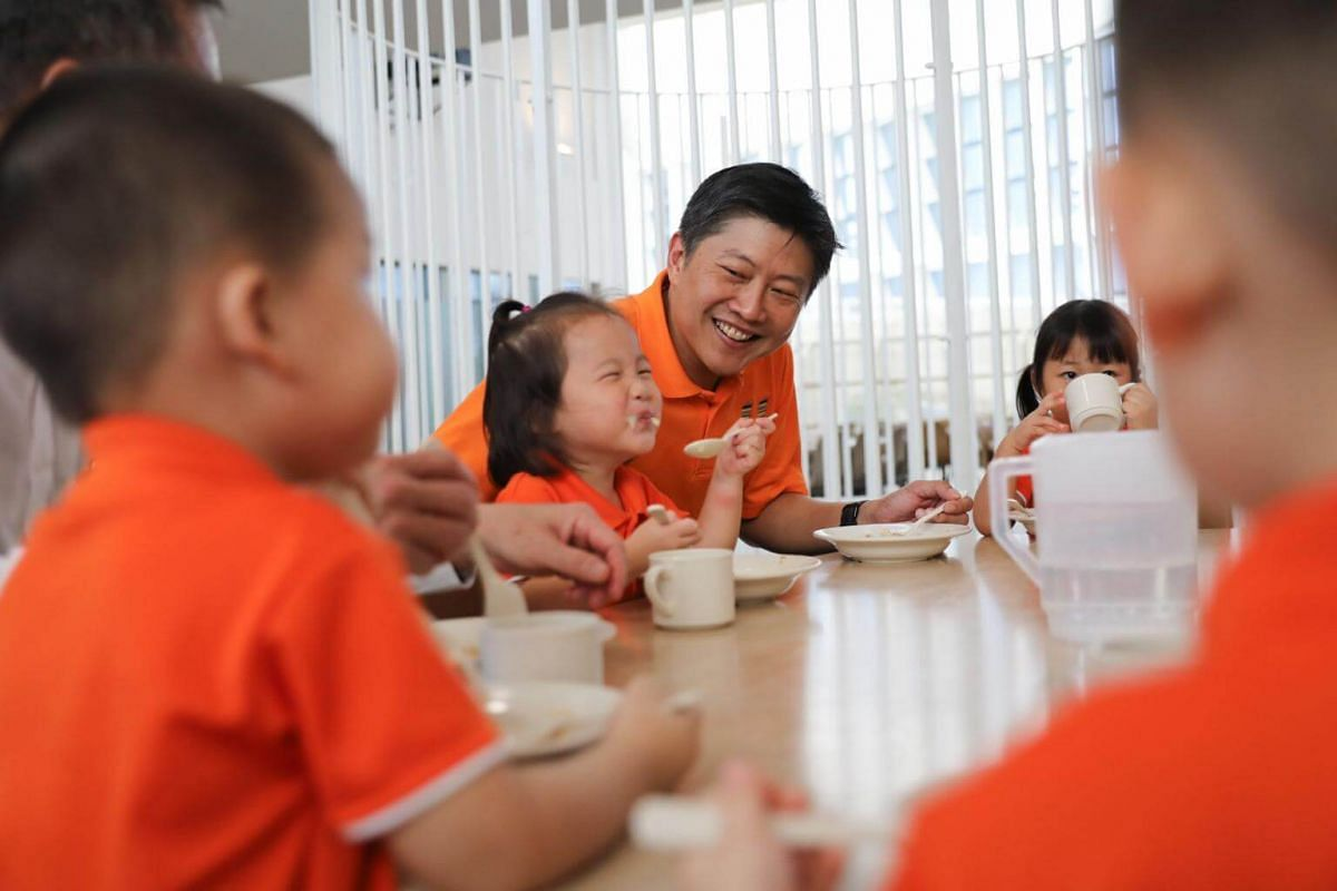 NTUC Secretary-General Ng Chee Meng eating and speaking with the children as he tours the Early Years Centre in Punggol.