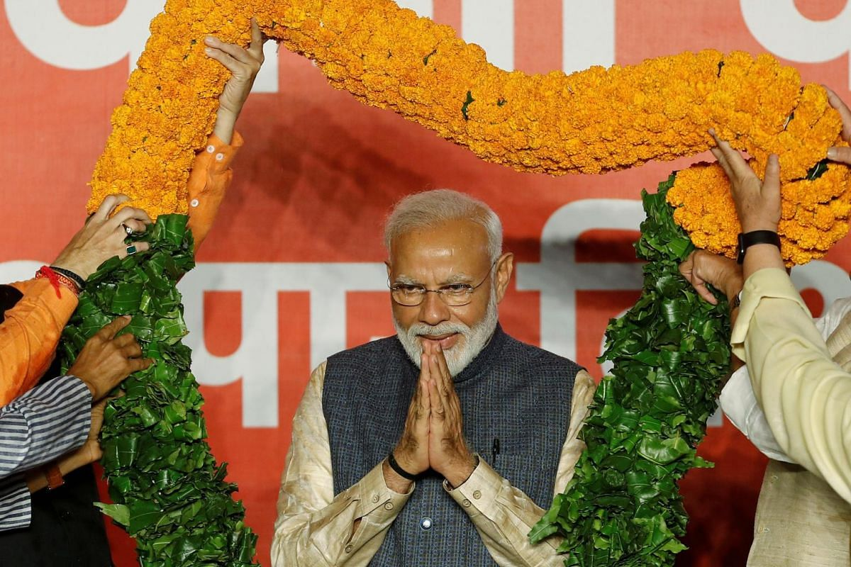 Indian Prime Minister Narendra Modi gestures as he is presented with a garland by Bharatiya Janata Party (BJP) leaders after the election results in New Delhi, India, on May 23, 2019.