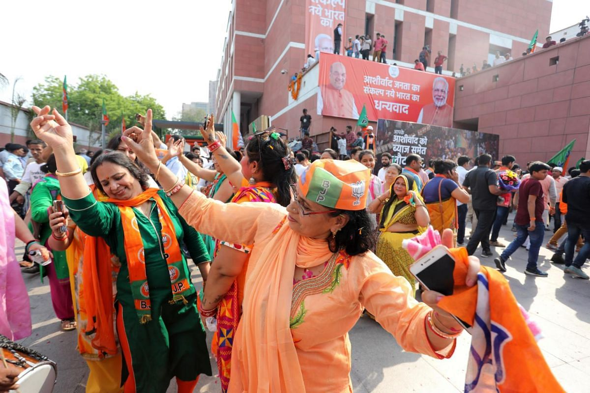 Supporters celebrate during an event at the Bharatiya Janata Party headquarters in New Delhi, on May 23, 2019.