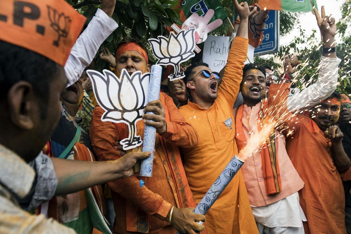 Supporters of the Bharatiya Janata Party celebrate in New Delhi as the vote count increases, on May 23, 2019.
