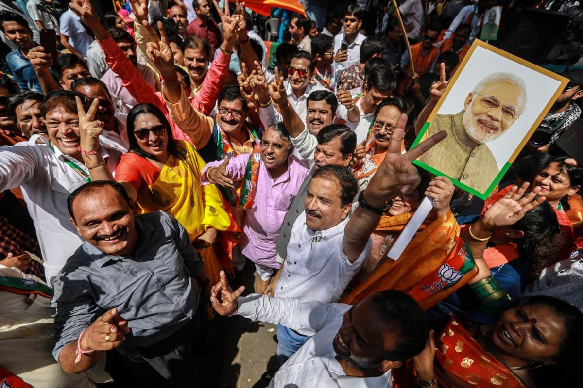 Bharatiya Janata Party (BJP) supporters celebrate the BJP's potential win as votes are counted for the Lok Sabha election in Mumbai, on May 23, 2019.