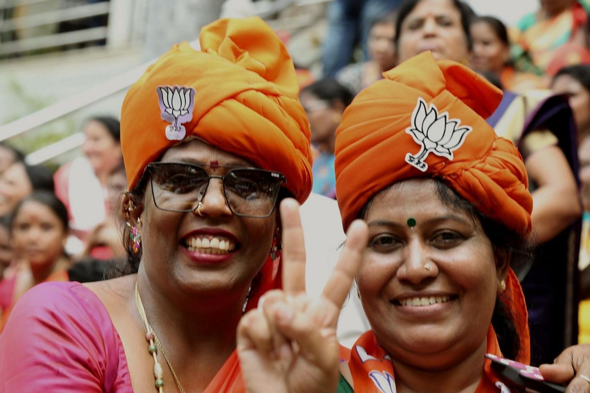 Bharatiya Janata Party supporters celebrate BJP's potential win as votes are counted for the Lok Sabha election in Bangalore, on May 23, 2019.