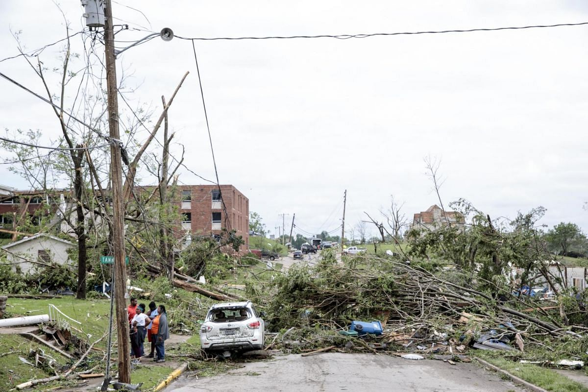 A pile of debris left by the tornado the night before blocks a road in Jefferson City on May 23, 2019.
