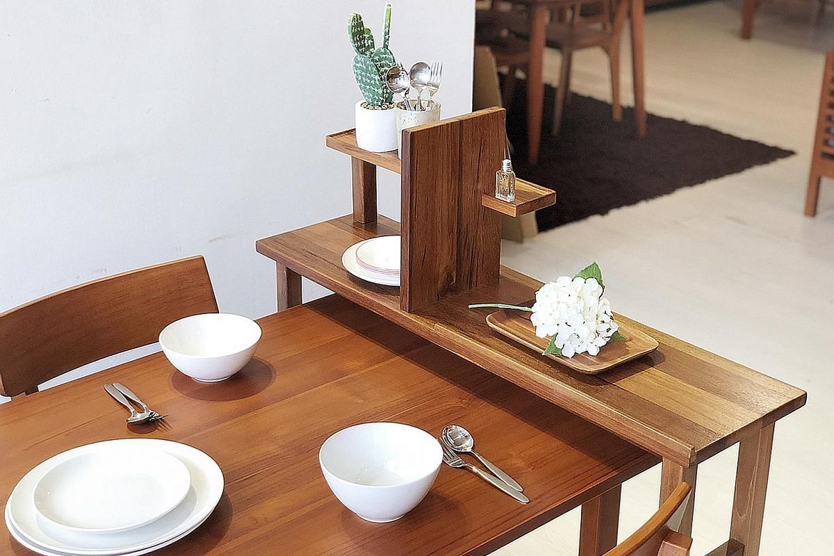 The Borne desk ($959) is a simple writing table with a swivel extension that allows parent and child to work together while the Entente Divider ($399) can be used as a table divider, a dining table extension (above) or as a console table on its own.