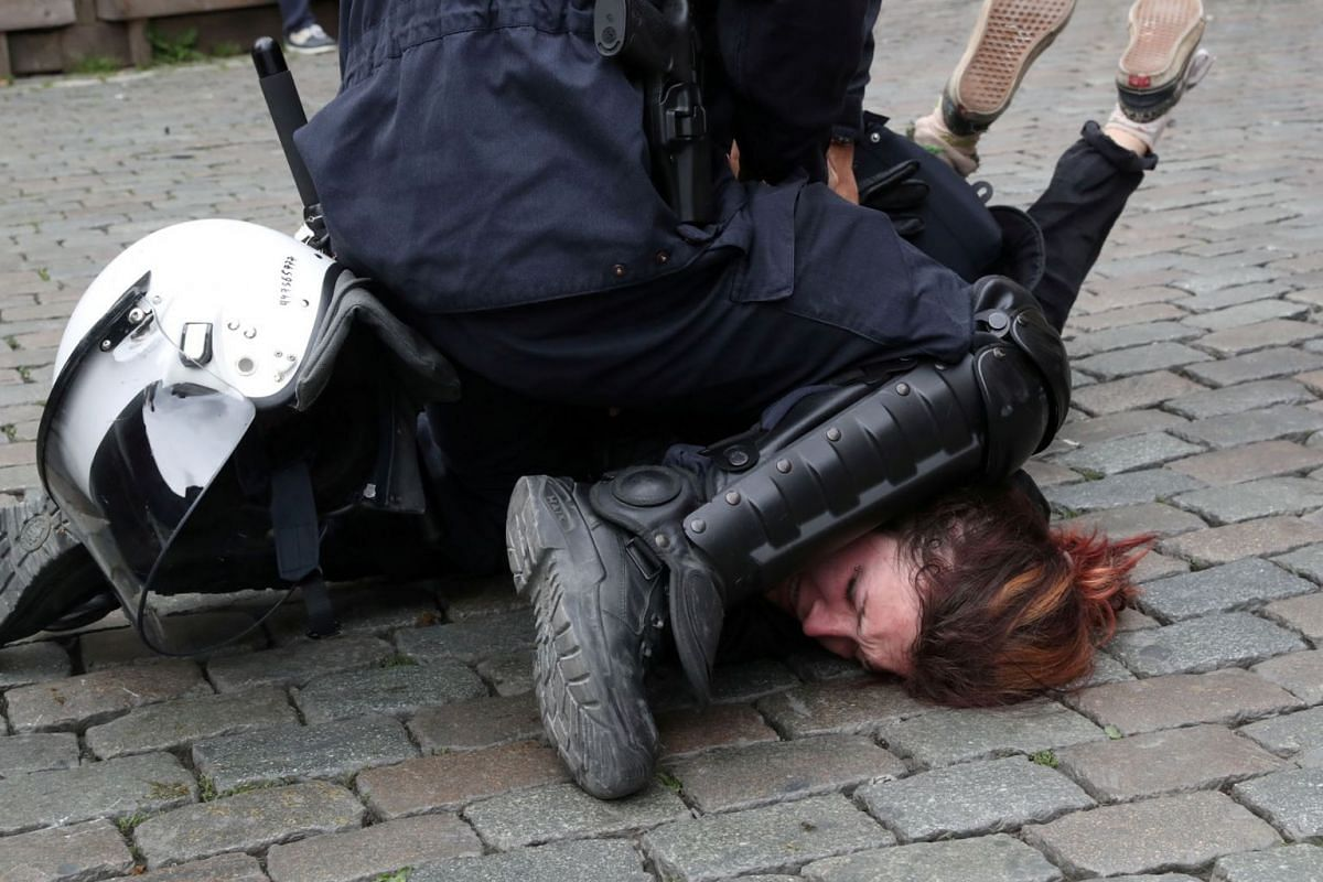 "A European ""yellow vests"" protester is detained by police during the last day of the European Parliament elections in Brussels, Belgium May 26, 2019. PHOTO: REUTERS"