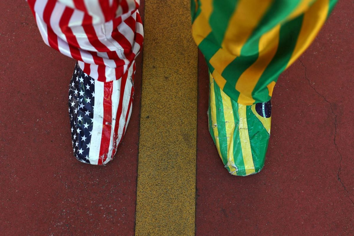 A man uses shoes with U.S and Brazil's colors as he takes part in a pro-government demonstration at Paulista avenue in Sao Paulo, Brazil May 26, 2019. PHOTO: REUTERS