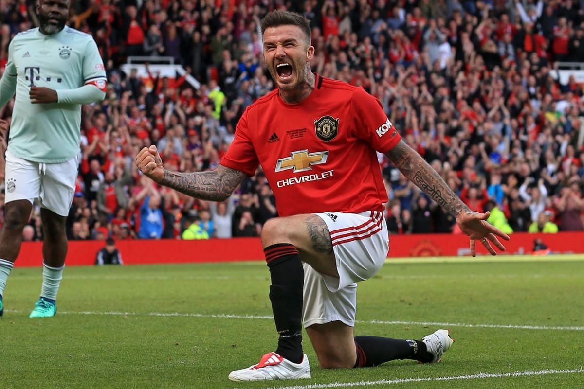 Manchester United '99 Legends player David Beckham celebrates after scoring their fifth goal during the Treble Reunion 20th anniversary football match between Manchester United '99 Legends and FC Bayern Legends at Old Trafford in Manchester, north-we