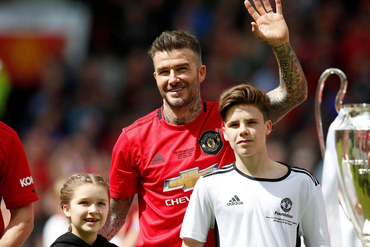 Manchester United '99 Legends' David Beckham with daughter Harper and son Romeo before the Treble Reunion 20th anniversary football match at Old Trafford, on May 26, 2019.