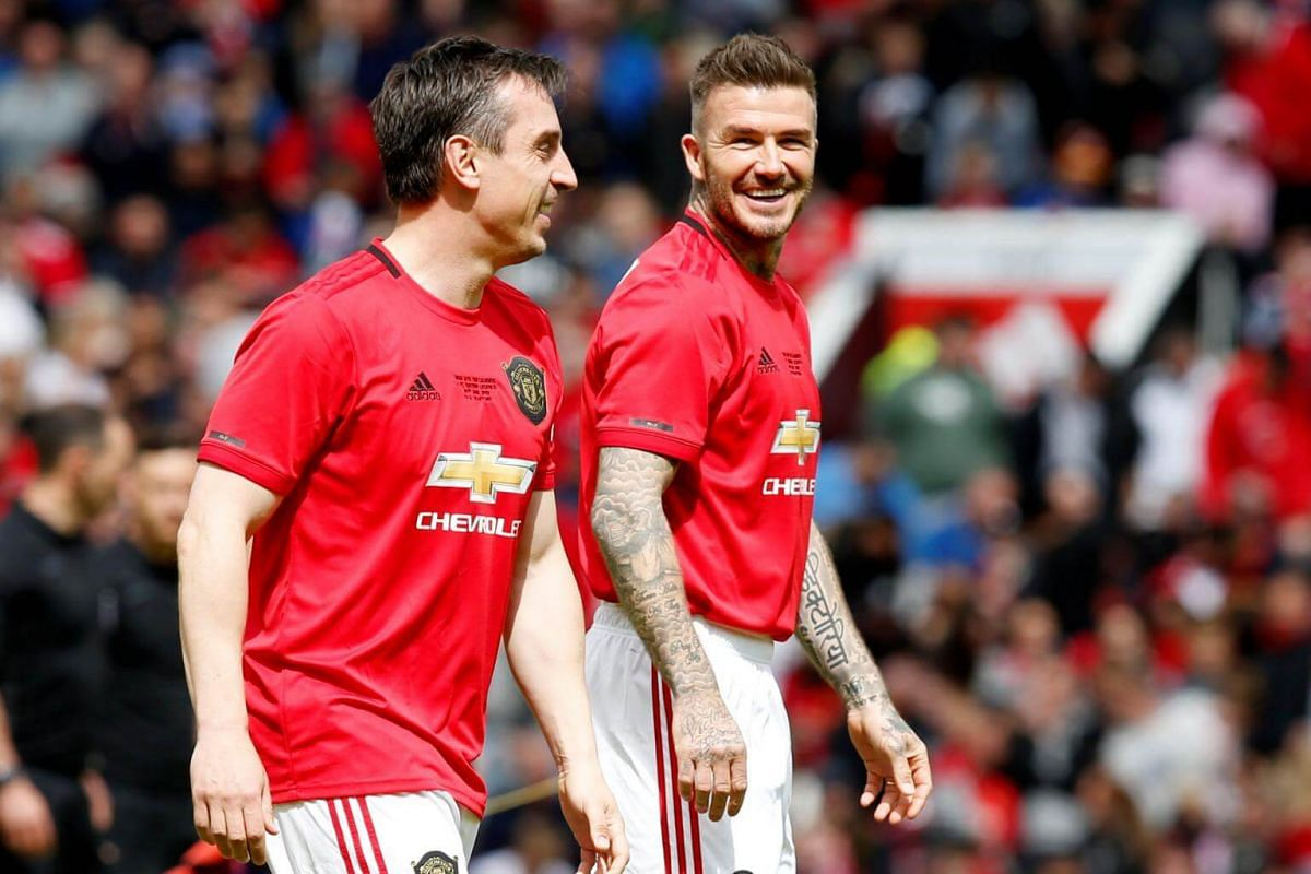 Manchester United '99 Legends' Gary Neville (left) and David Beckham before the Treble Reunion 20th anniversary football match at Old Trafford, on May 26, 2019.