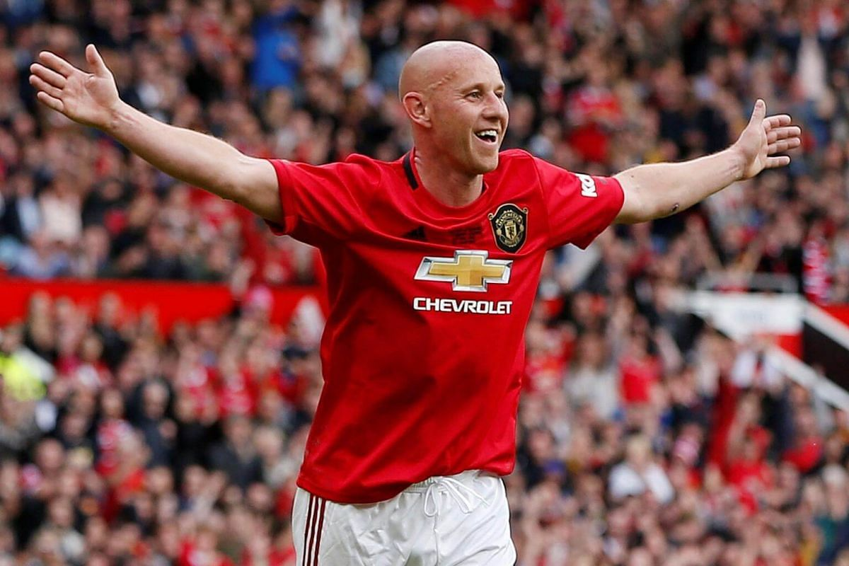 Manchester United '99 Legends' Nicky Butt celebrates scoring their third goal during the Treble Reunion 20th anniversary football match at Old Trafford, on May 26, 2019.