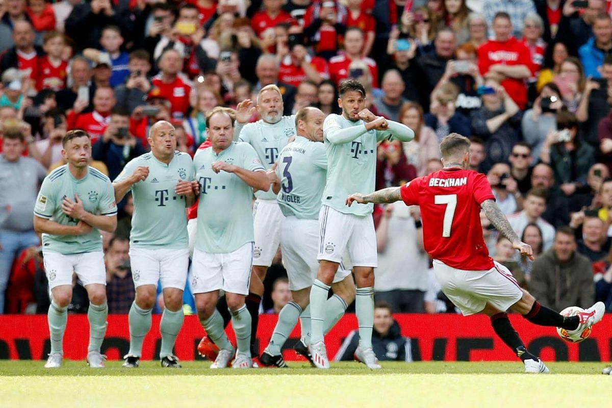 Manchester United '99 Legends' David Beckham shoots at goal from a free kick during the Treble Reunion 20th anniversary football match at Old Trafford, on May 26, 2019.