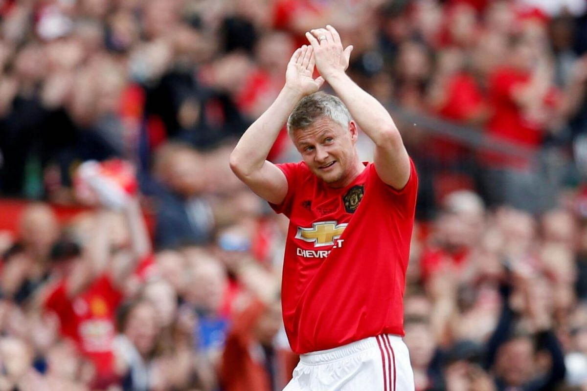 Manchester United '99 Legends' Ole Gunnar Solskjaer applauds the fans as he is substituted during the Treble Reunion 20th anniversary football match at Old Trafford, on May 26, 2019.