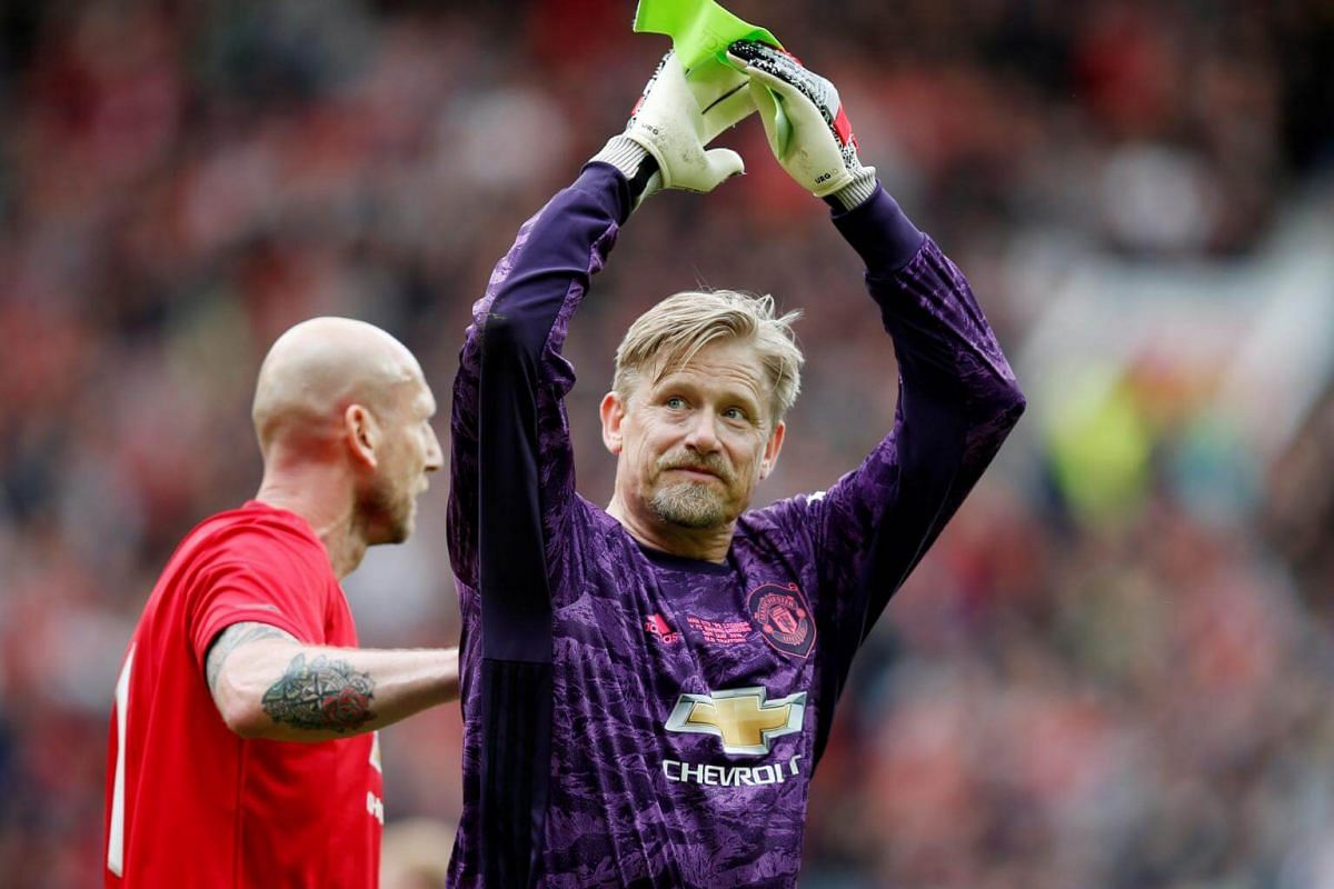 Manchester United '99 Legends' Peter Schmeichel applauds the fans as he is substituted during the Treble Reunion 20th anniversary football match at Old Trafford, on May 26, 2019.