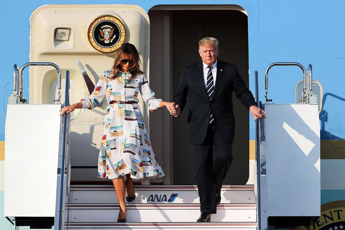 US President Donald Trump and first lady Melania Trump disembark from Air Force One as they arrive at Haneda International Airport in Tokyo, Japan, on May 25, 2019.