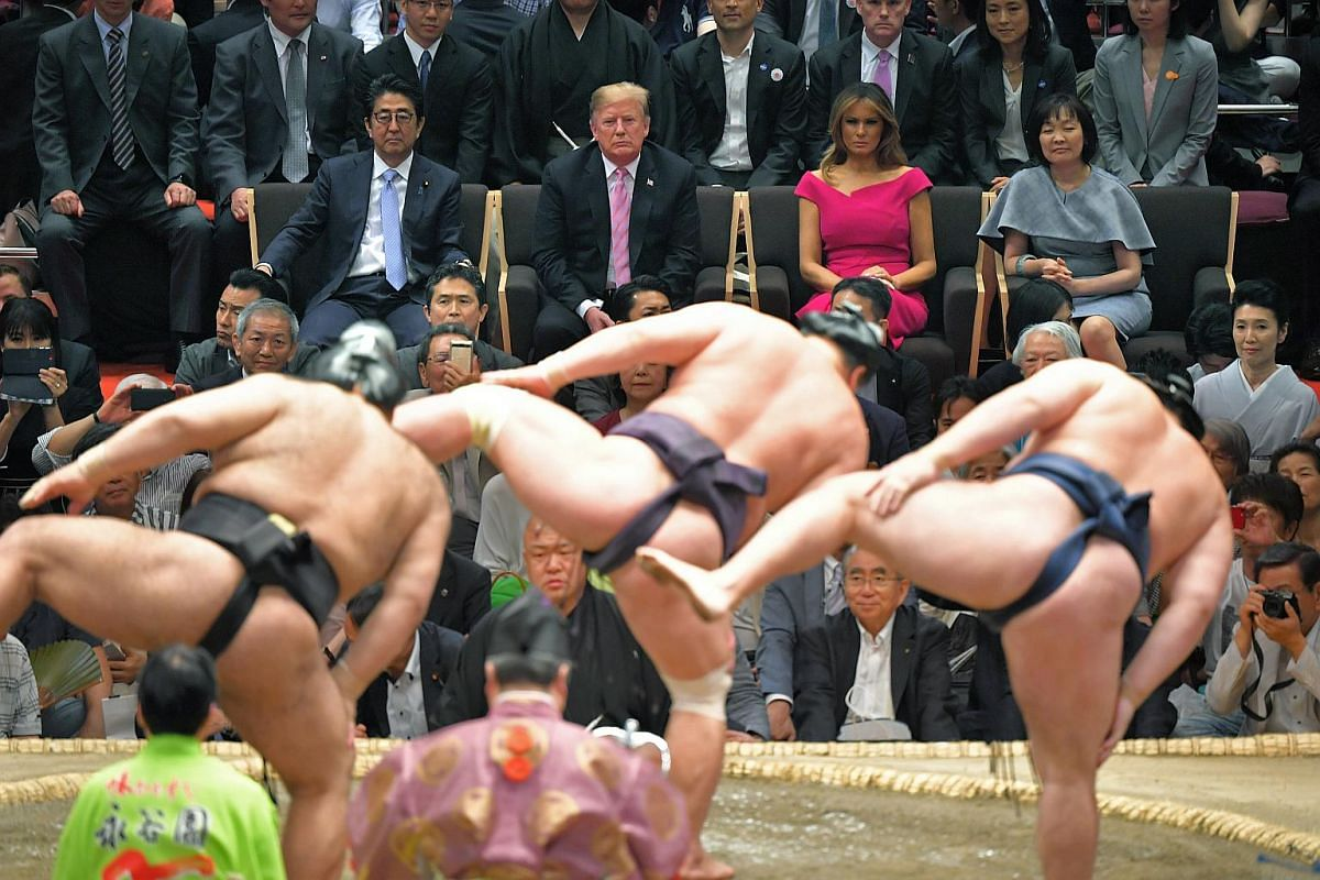 Japanese Prime Minister Shinzo Abe, US President Donald Trump, first lady Melania Trump, and Mr Abe's wife Akie watch a sumo wrestling tournament at Ryogoku Kokugikan in Tokyo, Japan, on May 26, 2019.